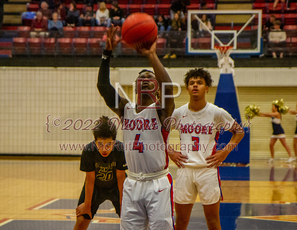 Moore's Siya Jackson shooting free-throws during the game on Tuesday, December 18, 2018 at Moore High School.