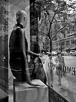 A mannequin at Emilio Pucci patiently observes window shopper on Madison Avenue, New York City.