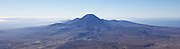 Panoramic view of active volcano Mount Ngauruhoe and the surrounding landscape in Tongariro National Park, New Zealand.