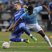 Ferando Torres, (left) is tackled by Abdul Razak, Manchester City, during the Manchester City V Chelsea friendly exhibition match at Yankee Stadium, The Bronx, New York. Manchester City won the match 5-3. New York. USA. 25th May 2012. Photo Tim Clayton