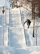 A woman precariously walks down some frozen steps in Tromso, Norway