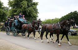Racegoers in a horse drawn carriage during day two of Royal Ascot at Ascot Racecourse