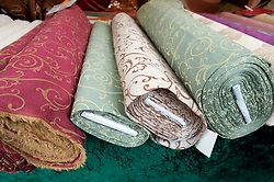 Patterned fabrics for sale at Turkish market on Maybachufer in Kreuzberg district of Berlin Germany