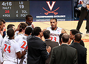 CHARLOTTESVILLE, VA- December 3: Mike Scott #23 of the Virginia Cavaliers stands in the huddle during the game against the Longwood Lancers on December 27, 2011 against the Longwood Lancers at the John Paul Jones Arena in Charlottesville, Virginia. Virginia defeated Longwood 86-53. (Photo by Andrew Shurtleff/Getty Images) *** Local Caption *** Mike Scott