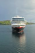 Hurtigruten ship 'Trollfjord' arriving at port of Rorvik, Norway
