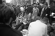National Farmer's Association sit-down at Department of Agriculture. Rickard Deasy (with beret) and other protesters, seated at a camp of folding chairs on the edge of the road outside the Department of Agriculture, passes the time by reading the newspaper and chatting with sympathisers..20.10.1966