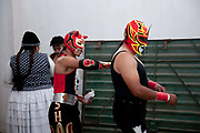Male wrestlers oiling up backstage before match. Lucha Libre wrestling origniated in Mexico, but is popular in other latin Amercian countries, including in La Paz / El Alto, Bolivia. Male and female fighters participate in the theatrical staged fights to an adoring crowd of locals and foreigners alike.