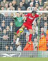 19/12/2004 - FA Barclays Premiership - Liverpool v Newcastle United - Anfield, Liverpool<br />Liverpool's winning goalscorer Milan Baros challenges Newcastle United's goalkeeper Shay Given for the ball in the penalty area.<br />Photo:Jed Leicester/Back Page Images