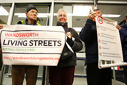 © Licensed to London News Pictures. 20/12/2011. London, UK. Campaign groups The London Cycling Campaign, Road Peace and London Living Streets held a candlelit Christmas vigil outside Kings Cross Station this evening (2011/12/20) to remember loved ones and highlight the high cyclist death toll on London's roads. The campaigners are calling on Mayor Boris Johnson to rethink the design of major junctions in order to more safely accommodate cyclists. Photo credit: Brian Duckett/LNP