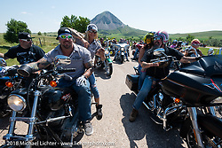 Jack Schit and Will Ramsey with Jessica Seidl on the Cycle Source Ride during the 78th annual Sturgis Motorcycle Rally. Sturgis, SD. USA. Wednesday August 8, 2018. Photography ©2018 Michael Lichter.