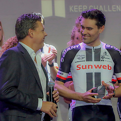 04-01-2018: Wielrennen: Presentatie Team Sunweb: Berlijn<br /> Tom Dumoulin recieves a trophee from the Association International Journaliste Cyclisme from AIJC chairman Raymond Kerckhoffs
