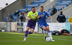 Luke Norris of Colchester United and Pierce Sweeney of Exeter City tussle for the ball - Mandatory by-line: Arron Gent/JMP - 18/06/2020 - FOOTBALL - JobServe Community Stadium - Colchester, England - Colchester United v Exeter City - Sky Bet League Two Play-off 1st Leg