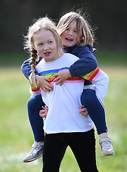 Autumn Phillips and Isla Phillips attend the Gatcombe Horse Trials at Gatcombe Park, Minchinhampton, Gloucestershire, UK, on the 23rd March 2019. 23 Mar 2019 Pictured: Savannah Phillips gives cousin Mia Tindall a piggyback as they attend the Gatcombe Horse Trials at Gatcombe Park, Minchinhampton, Gloucestershire, UK, on the 23rd March 2019. Photo credit: James Whatling / MEGA TheMegaAgency.com +1 888 505 6342