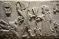 """Photo of Neo-Hittite orthostat from Karkamis, Turkey.  The meeting of the """"Storm God"""" on right and a King on the left. An Ankara Museum of Anatolian Civilizations exhibit."""
