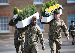 © Licensed to London News Pictures. 01/03/2012. Hounslow, UK.  Members of the Welsh Guards carrying beds of daffodils before HRH Prince Charles presented leeks to 1st Battalion The Welsh Guards at Cavalry Barracks,  Hounslow, London on St David's Day, March 1st, 2012.  Two-thirds of the Battalion's 600 soldiers are due to be deployed to Afghanistan in the next two weeks. Photo credit : Ben Cawthra/LNP
