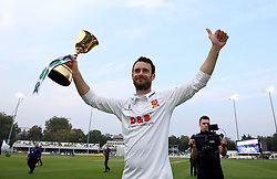 Essex's James Foster holding the Division 1 Championship Trophy after day three of the Specsavers County Championship, Division One match at the Cloudfm County Ground, Chelmsford.