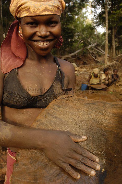 Panning for gold. This mining is now illegal as it is taking place in the protected forest of Daraina which is the habitat for the<br />Golden-crowned sifaka or Tattersall's sifaka (Propithecus tattersalli) in North-east MADAGASCAR<br />FANANBY a local Madagascar NGO is working in Daraina to proclaim a protected site of about 20,000 ha. The gold mining is still quite common in the forest and trees are falling over as the ground is littered with deep pits from the excavations of these miners.