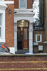 A detective enters the Victorian house converted to 12 flats at 65 Craven Park Road, Harlesden, West London, where two Improvised Explosive Devices were discovered by workers refurbishing a flat. Harlesden, London, November 22 2018.