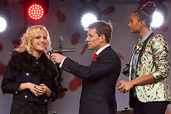 © Licensed to London News Pictures. 24/10/2012. LONDON, UK. TV presenter Ben Shephard is seen talking with singer Pixie Lott (L) and X-Factor judge Alesha Dixon (R) at the launch of the Royal British Legion's 2012 Poppy Appeal in Trafalgar Square, London, today (24/10/12).  Photo credit: Matt Cetti-Roberts/LNP