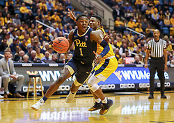 Dec 8, 2018; Morgantown, WV, USA; Pittsburgh Panthers guard Xavier Johnson (1) drives past West Virginia Mountaineers guard Brandon Knapper (2) during the first half at WVU Coliseum. Mandatory Credit: Ben Queen-USA TODAY Sports
