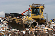A worker uses a bulldozer to move waste at a landfill outside Orlando, Florida.