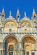 Facade with details of the Romanesque pillars & mosaics  of St Mark's Basilica, Venice