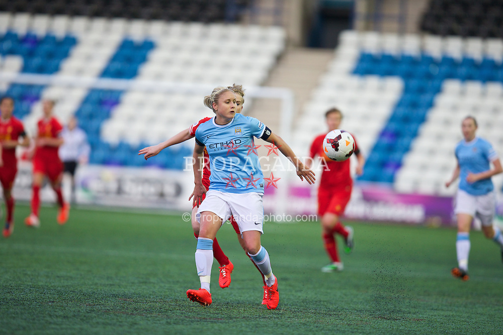 WIDNES, ENGLAND - Thursday, April 17, 2014: Manchester City Ladies captain Steph Houghton in action against Liverpool during the FA Women's Super League match at the Halton Stadium. (Pic by David Rawcliffe/Propaganda)