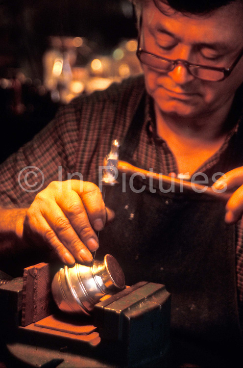 """A Silversmith etches his many years experience into the making of a Silver gourde from which to drink """"Mate"""" tea (Yerba Mate) in Buenos Aires' most famous Silversmith family, the Pallarols originally from Catalunya, Spain."""