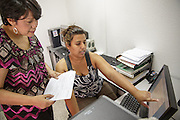 PAI sub-chief Lourdes Mendoza (left) and systems attendant Denia Ochoa use a vaccine stock management system at the PAI (Programa Ampliado de Inmunizaciones) offices in Tegucigalpa, Honduras, on Wednesday April 24, 2013..