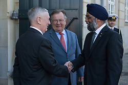 Secretary of Defense Jim Mattis and Danish Minister of Defence Claus Hjort Frederiksen welcome Harjit Sajjan, Canada's minister of national defence, to a Global Coalition on the Defeat of ISIS meeting at Eigtveds Pakhus in Copenhagen, Denmark, May 9, 2017. (DOD photo by U.S. Air Force Staff Sgt. Jette Carr)