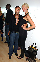 Fashion designer JULIEN MACDONALD and actress MARGO STILLEY at the launch of 'Blow Lips' a new lipstick by Isabella Blow and MAC Makeup held at the the Blow de la Barra Gallery, 35 Heddon Street, London on 7th September 2005.<br />