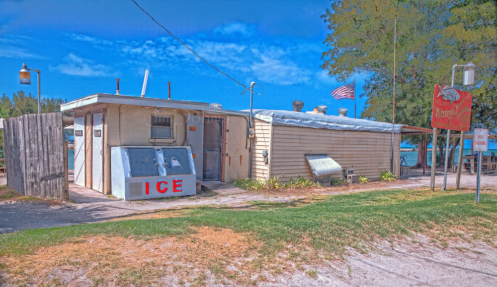 Located on the south end of Casey Key the Nokmis Fishcamp has been around awhile. The main structure was a Tampa streetcar which was barged to the current location. There is plenty of shade to sip a cold beer and watch those fishing.
