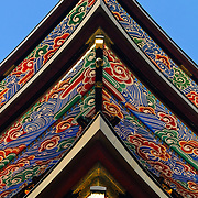 Ornately and colorfully painted rafters of the Three Storied Pagoda. Standing 25 meters tall, it was originally built in 1712. It is ornately decorated with brightly painted rafters, carved dragons, and sculptures of 16 RAKAN or Buddha's disciples how attained Nirvana. On the first floor's inner sanctum is GOCHI-NYORAI (Five Tathagas) who is believed to be endowed with the five wisdoms of Buddha. The Narita-san temple, also known as Shinsho-Ji (New Victory Temple), is Shingon Buddhist temple complex, was first established 940 in the Japanese city of Narita, east of Tokyo.