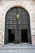 Ancient wooden doors of San Nicolas Tolentino Temple and Ex-Monastery in Actopan, Hidalgo, Mexico. The colonial church and convent  was built in 1546 and combine architectural elements from the romantic, gothic and renaissance periods.