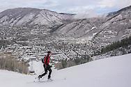 A skier skins up Aspen Mountain in Aspen, Colorado.