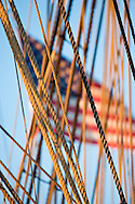 ensign (US flag) behind ropes on the Lady Washington a full size replica of the 112 ft Brig