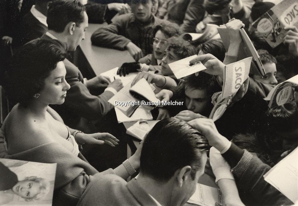 """Paris, 1955, famous French movie star<br /> Martine Carol at the """"Kermesse des Etoiles"""" signing autographs.<br /> <br /> Paris, 1955, célèbre star de cinéma français Martine Carol à la """" Kermesse des Etoiles"""" signant des autographes ."""