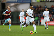 Jordan Ayew of Swansea city in action.Premier league match, Swansea city v Burnley at the Liberty Stadium in Swansea, South Wales on Saturday 4th March 2017.<br /> pic by Andrew Orchard, Andrew Orchard sports photography.