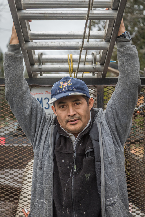 Ignacio Barreda works with my neighbor, Fred Constantine, to clear gutters and remove holiday decorations on School Street in Calistoga.