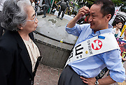 """Hiroshi Yamada of The Spirit of Japan (Nippon Soshinto) which is right Wing/Nationalist) political party with ties to the  Shinzo Abe-led bipartisan group of lawmakers, """"Sosei-Nippon,"""" and the Sunrise Party of Japan, led by Takeo Hiranuma, campaigning in Hachiko Square in Shibuya, Tokyo, Japan June 26th 2010"""
