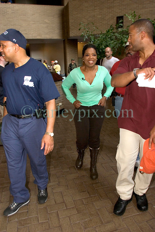 04 Sept  2005. New Orleans, Louisiana. <br /> Post hurricane Katrina.<br /> Oprah Winfrey, US talk show host, visits the Hyatt Hotel in New Orleans as she prepares to survey the hurricane damage. Here surrounded by her security detail.<br /> Photo Credit ©: Charlie Varley/varleypix.com