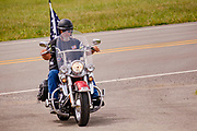 29 AUGUST 2020 - RUNNELLS, IOWA: A member of the Patriot Guard Riders arrives at the funeral for Pvt. Roy Brown Jr.'s funeral in Runnells, IA. Pvt. Brown was a US Army soldier in World War II. He was an infantryman in the 126th Infantry Regiment, 32nd Infantry Division, serving in the Australian Territory of Papua (now Papua New Guinea). He went missing in action on Dec. 2, 1942. Unidentified remains were recovered on Feb. 2, 1943 and were eventually interred in the Manila American Cemetery. On May 14, 2019, Defense POW/MIA Accounting Agency using dental records, circumstantial evidence and DNA identified the remains as Pvt. Brown's. He was reinterred in the Lowman Cemetery in Runnells Saturday.     PHOTO BY JACK KURTZ