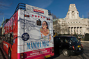 Bus rear advertising for Abba's West End musical Mamma Mia as it drives through central London streets.
