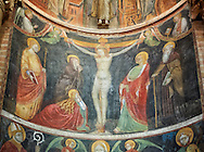 Frescoes depicting the crucifixion on the interior of the Romanesque Baptistery of Parma, circa 1196, (Battistero di Parma), Italy .<br /> <br /> If you prefer you can also buy from our ALAMY PHOTO LIBRARY  Collection visit : https://www.alamy.com/portfolio/paul-williams-funkystock/romanesque-art-antiquities.html<br /> Type -     Parma    - into the LOWER SEARCH WITHIN GALLERY box. <br /> <br /> Visit our ROMANESQUE ART PHOTO COLLECTION for more   photos  to download or buy as prints https://funkystock.photoshelter.com/gallery-collection/Medieval-Romanesque-Art-Antiquities-Historic-Sites-Pictures-Images-of/C0000uYGQT94tY_Y