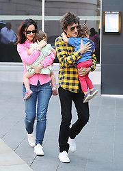 Ronnie Wood of The Rolling Stones and wife Sally Humphreys and children Gracie Jane Wood and Alice Roe Wood turn up at the Manchester hotel on Sunday evening ahead of the gig at Old Trafford Football Stadium on Tuesday