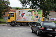 Alcohol delivery truck with full size picture of attractive couple enjoying wine. Rzeczyca Central Poland