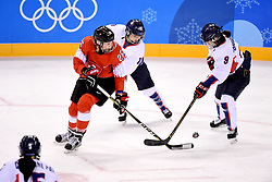 PYEONGCHANG, Feb. 10, 2018  Dominique Ruegg (L) of Switzerland vies for the puck with Park Jongah (R) of the unified team of the Democratic People's Republic of Korea (DPRK) and South Korea during their preliminary match of women's ice hockey at the Pyeongchang 2018 Winter Olympic Games at the Kwandong Hockey Centre in Gangneung, South Korea, on Feb. 10, 2018. (Credit Image: © Wang Song/Xinhua via ZUMA Wire)