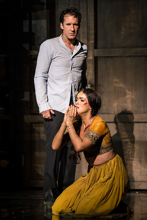 """LONDON, UK, 17 October, 2016.  Jacques Imbrailo (top, as """"Zurga"""") and Claudia Boyle (bottom, as """"Leila"""") rehearse for the revival of director Penny Woolcock's production of Bizet's opera """"The Pearl Fishers"""" at the London Coliseum for the English National Opera.  The production opens on 19 October."""