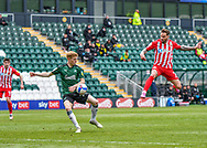 Sunderland Midfielder Chris Maguire (7) takes a shoot on goal while the ball hits the hand of Plymouth Argyle Defender Ryan Law (27)   during the EFL Sky Bet League 1 match between Plymouth Argyle and Sunderland at Home Park, Plymouth, England on 1 May 2021.