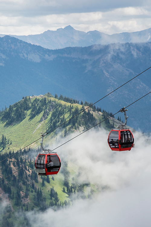 United States, Washington, Crystal Mountain gondola, valley and clouds in summer